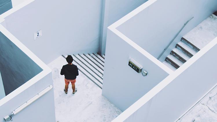 man in a white maze