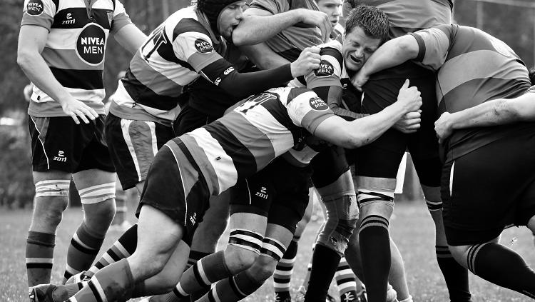 Image of rubgy players tackling