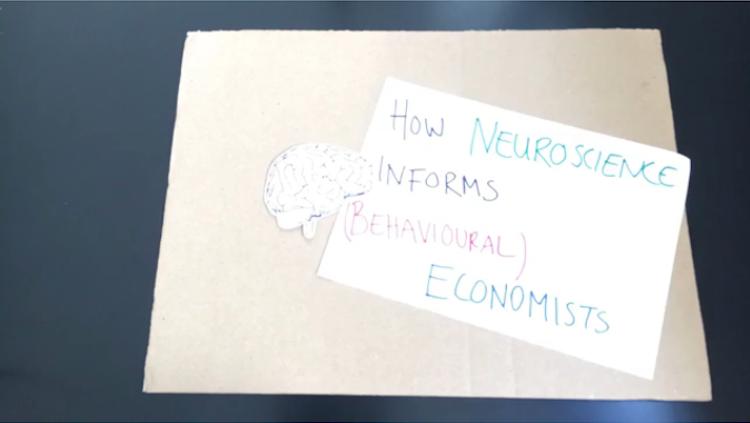 how neuroscience informs (behavioural) economists written in marker next to a cutout brain