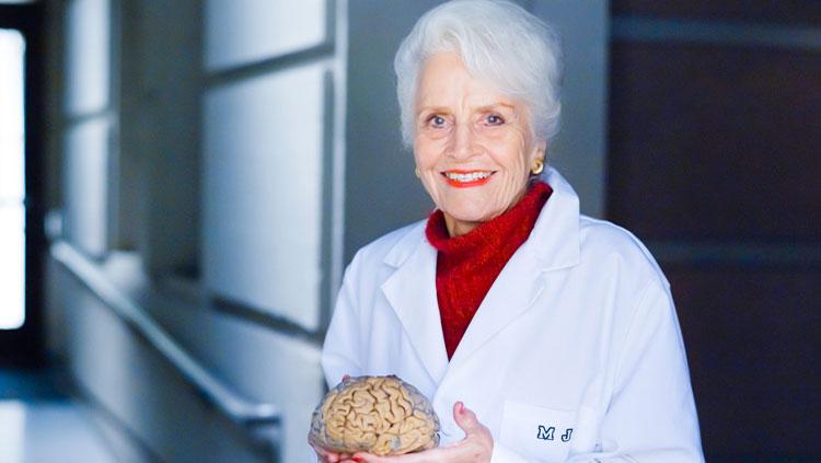 photo of marian diamond holding albert eisteins brain